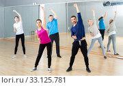 Купить «Females and males stretching at dance class», фото № 33125781, снято 7 июля 2020 г. (c) Яков Филимонов / Фотобанк Лори
