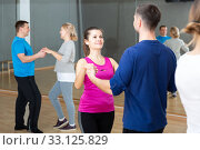 Young couple practicing active dance in pair. Стоковое фото, фотограф Яков Филимонов / Фотобанк Лори