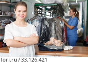 Купить «Satisfied client of dry cleaner», фото № 33126421, снято 9 мая 2018 г. (c) Яков Филимонов / Фотобанк Лори