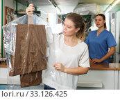 Купить «Displeased client of dry cleaning», фото № 33126425, снято 9 мая 2018 г. (c) Яков Филимонов / Фотобанк Лори
