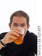Купить «Young man drinking beer», фото № 33127477, снято 25 февраля 2020 г. (c) PantherMedia / Фотобанк Лори