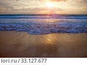 Купить «Sunset over the sea and the foam of the surf breaks on the sandy shore», фото № 33127677, снято 5 февраля 2010 г. (c) Куликов Константин / Фотобанк Лори