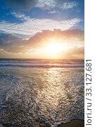 Купить «Sunset over the sea and the foam of the surf breaks on the sandy shore», фото № 33127681, снято 5 февраля 2010 г. (c) Куликов Константин / Фотобанк Лори