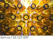 Купить «Yellow glass empty beer bottles lie in rows», фото № 33127697, снято 5 мая 2019 г. (c) Куликов Константин / Фотобанк Лори