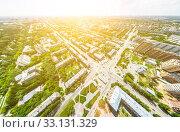 Купить «Aerial city view with crossroads and roads, houses, buildings, parks and parking lots. Sunny summer panoramic image», фото № 33131329, снято 29 марта 2020 г. (c) Александр Маркин / Фотобанк Лори