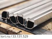 Купить «Aluminum profile with rough cut surface», фото № 33131529, снято 10 февраля 2020 г. (c) EugeneSergeev / Фотобанк Лори