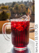 Купить «Spanish sangria with fruit and ice, outdoor, street cafe», фото № 33131725, снято 7 февраля 2015 г. (c) Gagara / Фотобанк Лори