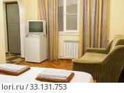 Купить «The interior of an ordinary room in an inexpensive hotel», фото № 33131753, снято 5 июня 2020 г. (c) Иванов Алексей / Фотобанк Лори