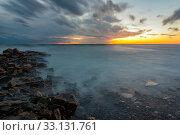 The waves rolling ashore with the help of long-lasting. Стоковое фото, фотограф Иванов Алексей / Фотобанк Лори