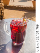 Купить «Spanish sangria with fruit and ice, outdoor, street cafe», фото № 33131769, снято 7 февраля 2015 г. (c) Gagara / Фотобанк Лори