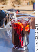 Купить «Spanish sangria with fruit and ice, outdoor, street cafe», фото № 33131793, снято 7 февраля 2015 г. (c) Gagara / Фотобанк Лори