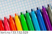 Many various felt tip pens on checkered sheet of paper. Стоковое фото, фотограф Яков Филимонов / Фотобанк Лори