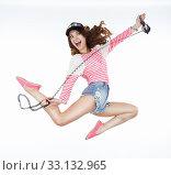 Lifestyle. Dynamic Animated Funny Woman Jumping. Freedom. Стоковое фото, фотограф Iryna Hramavataya / PantherMedia / Фотобанк Лори