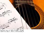 Купить «Classical guitar and notes», фото № 33135225, снято 15 июля 2020 г. (c) PantherMedia / Фотобанк Лори