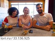 Купить «Front view friends looking at the camera», фото № 33136925, снято 15 ноября 2019 г. (c) Wavebreak Media / Фотобанк Лори
