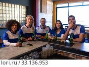 Купить «Supporters watching the match on TV», фото № 33136953, снято 15 ноября 2019 г. (c) Wavebreak Media / Фотобанк Лори