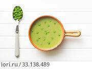 Купить «pea soup and peas in spoon», фото № 33138489, снято 6 июня 2020 г. (c) PantherMedia / Фотобанк Лори