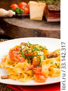 Купить «Photo of delicious pasta with bacon and tomatoes», фото № 33142317, снято 27 мая 2020 г. (c) easy Fotostock / Фотобанк Лори