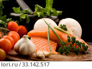 Купить «Photo of delicious salmon filet with lime and parsley on chopping board with vegetables arround», фото № 33142517, снято 27 мая 2020 г. (c) easy Fotostock / Фотобанк Лори