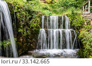 A small picturesque waterfall in the village of Argirupoli on the island of Crete, Greece (2017 год). Стоковое фото, фотограф Наталья Волкова / Фотобанк Лори