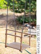 Купить «Square sit wooden swing hanging on ropes in backyard», фото № 33151393, снято 31 июля 2014 г. (c) Кекяляйнен Андрей / Фотобанк Лори