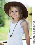 Купить «Portrait of preschool girl dressed sleeveless sports shirt and brown cowboy hat at summer season», фото № 33151405, снято 31 июля 2014 г. (c) Кекяляйнен Андрей / Фотобанк Лори