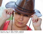 Купить «Western woman portrait with leather cowboy hat and speaking look», фото № 33151433, снято 31 июля 2014 г. (c) Кекяляйнен Андрей / Фотобанк Лори