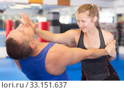 Young woman is fighting with trainer. Стоковое фото, фотограф Яков Филимонов / Фотобанк Лори