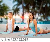 Купить «women doing sports on exercise mats outdoors», фото № 33152029, снято 28 июля 2019 г. (c) Syda Productions / Фотобанк Лори