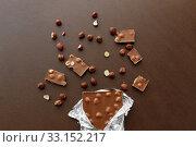 Купить «milk chocolate bar with hazelnuts in foil wrapper», фото № 33152217, снято 1 февраля 2019 г. (c) Syda Productions / Фотобанк Лори