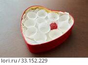 Купить «one candy in red heart shaped chocolate box», фото № 33152229, снято 1 февраля 2019 г. (c) Syda Productions / Фотобанк Лори
