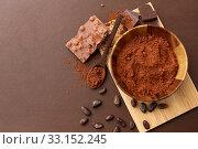 Купить «chocolate with hazelnuts, cocoa beans and powder», фото № 33152245, снято 1 февраля 2019 г. (c) Syda Productions / Фотобанк Лори