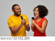 Купить «happy african couple singing to hairbrushes», фото № 33152285, снято 15 декабря 2019 г. (c) Syda Productions / Фотобанк Лори