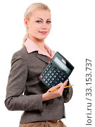 Young businesswoman with calculator - isolated on white background. Стоковое фото, фотограф Zoonar.com/DenisNata / age Fotostock / Фотобанк Лори