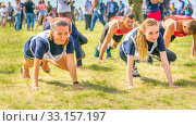 Купить «Russia, Samara, June 2019: young beautiful women is engaged in sports exercises at a city holiday.», фото № 33157197, снято 8 июня 2019 г. (c) Акиньшин Владимир / Фотобанк Лори