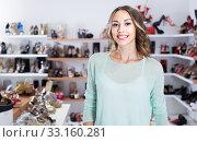 Купить «Portrait of woman who is buying fashion footwear in boutique.», фото № 33160281, снято 17 августа 2017 г. (c) Яков Филимонов / Фотобанк Лори