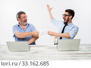 Купить «The two colleagues working together at office on white background», фото № 33162685, снято 8 июля 2020 г. (c) PantherMedia / Фотобанк Лори