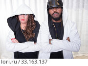 Rapper style couple is posing. Стоковое фото, фотограф Jürgen Hüls / PantherMedia / Фотобанк Лори