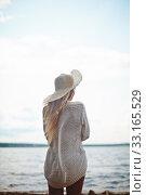 Купить «Rear view of female spending vacation by the sea», фото № 33165529, снято 8 апреля 2020 г. (c) PantherMedia / Фотобанк Лори