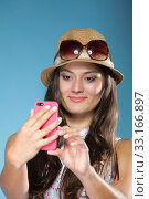 Купить «technology and internet. happy woman using cellphone texting on mobile phone. teen girl reading sms on smartphone,taking selfie on blue», фото № 33166897, снято 31 мая 2020 г. (c) PantherMedia / Фотобанк Лори