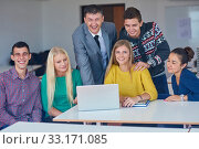 Купить «group of students getting suppport from teacher», фото № 33171085, снято 26 мая 2020 г. (c) PantherMedia / Фотобанк Лори