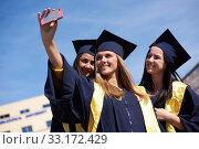 students group in graduates making selfie. Стоковое фото, фотограф benis arapovic / PantherMedia / Фотобанк Лори