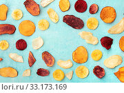 Купить «Dry fruit and vegetable chips, healthy vegan snack, an organic food flat lay pattern on a blue background, forming a frame with copy space», фото № 33173169, снято 6 июня 2020 г. (c) easy Fotostock / Фотобанк Лори