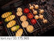 Tasty vegetables and mushrooms in grill grate. Стоковое фото, фотограф Гурьянов Андрей / Фотобанк Лори