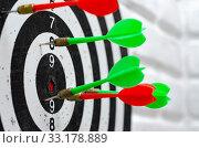 Купить «Darts stick out in round target in dartgame game», фото № 33178889, снято 14 августа 2019 г. (c) Иванов Алексей / Фотобанк Лори
