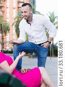 Купить «Stranger man is talking with young female who is resting», фото № 33180681, снято 18 октября 2017 г. (c) Яков Филимонов / Фотобанк Лори