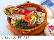 Купить «Soup of lamb with vegetables, lemon, onion and greens, served in bowl», фото № 33181121, снято 16 августа 2018 г. (c) Яков Филимонов / Фотобанк Лори