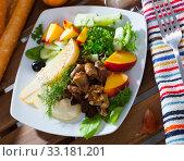 Купить «Salad with roasted chicken hearts, fried cheese, pear, peach», фото № 33181201, снято 29 марта 2020 г. (c) Яков Филимонов / Фотобанк Лори