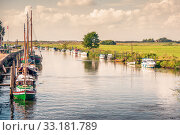 Купить «Boats on a river canal», фото № 33181789, снято 31 мая 2020 г. (c) PantherMedia / Фотобанк Лори