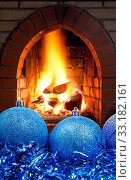 blue Christmas balls and tinsel with fireplace. Стоковое фото, фотограф Valery Vvoennyy / PantherMedia / Фотобанк Лори